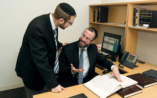 Rabbi Shmuel Maybruch of Passaic, seated, designed the webinar with Rabbi Naphtali Lavenda, director of online rabbinic programming at YU's Center for the Jewish Future.