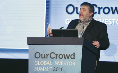 Jonathan Medved, founder and CEO of OurCrowd, speaks at the investor summit. (Courtesy OurCrowd)