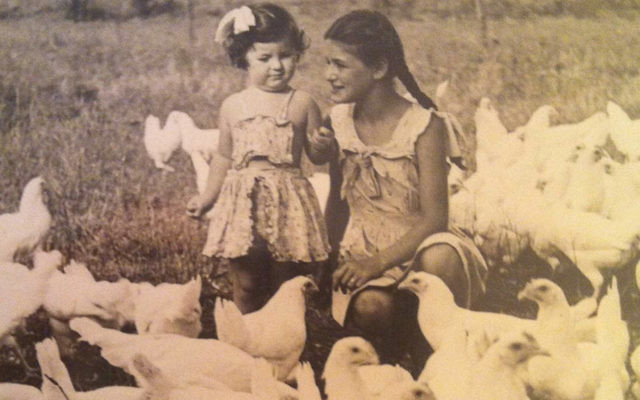 Vera Greenwald recently, and with her younger sister, Eva, on the family chicken farm in Vineland.