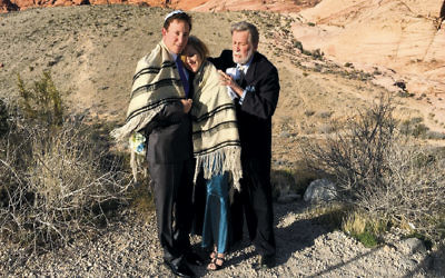Rabbi Mel Hecht marries Craig Silver and Karen Butt of Connecticut at Red Rock Canyon near Las Vegas on February 12.