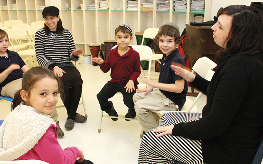 Music teacher Erika Svolos, right, with a group of students. Photos courtesy of Sinai Schools