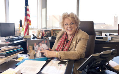 """Las Vegas Mayor Carolyn Goodman, showing a family photo in her office last week, says the """"Clinton names means a whole lot here."""" (Ron Kampeas)"""