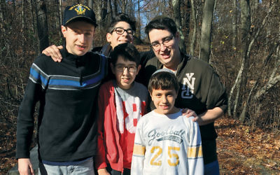 Eagle Scout Avi Samuel; his older brother, Adam Samuel; Zachary Fishman; Avi's cousin Zachary Samuel, and Yoni Stern worked on the Tenafly Nature Center footboard project. (David Samuel)