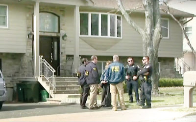 FBI agents and police officers conducted a series of raids in Ramapo on March 16. (Screenshot from YouTube)