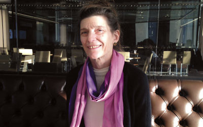Editor and translator Ann Goldstein sits in the Condé Nast cafeteria at One World Trade Center.