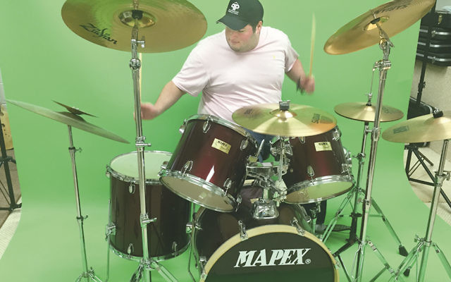 Jeremy Katz, plays the drums in his Teaneck home studio.