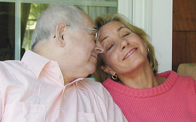 Cantor Kurt Silberman and his daughter, Judy Freilich, laughed together at Ms. Freilich's Englewood home a few years ago. (COURTESY ARY FREILICH)
