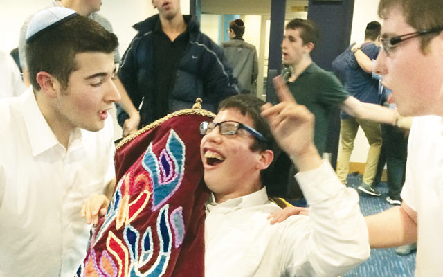 TABC and Sinai students celebrate together with a sefer Torah.