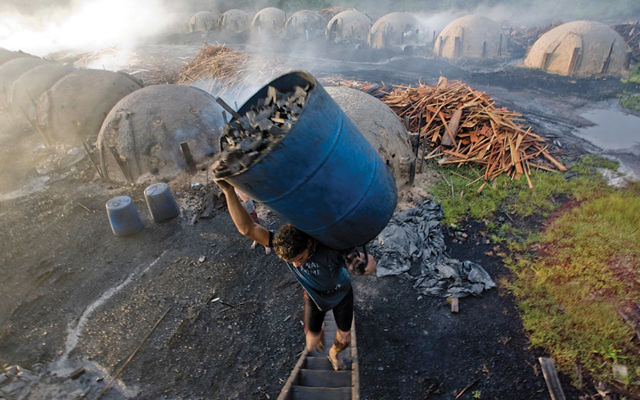 We're all connected to modern slavery in ways that aren't always easy to spot. In Brazil, scrap timber from Amazon logging operations is turned into charcoal, which fuels smelters to make pig iron, which is used to make steel that winds up in cars, toys, appliances and skyscrapers. (Kay Cherish)