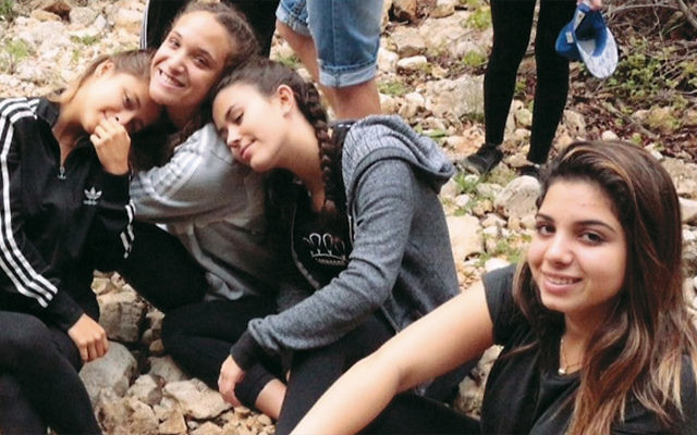 Danielle Haziza, 16, of Upper Saddle River takes a break with classmates from Mosenson Youth Village.