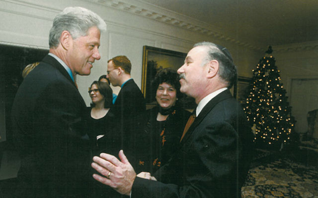Rabbi Robert and Helene Fine meet President Bill Clinton at the White House in December 2000, a few months after they hosted Hillary and Chelsea Clinton at their seder. (Bob Fine)