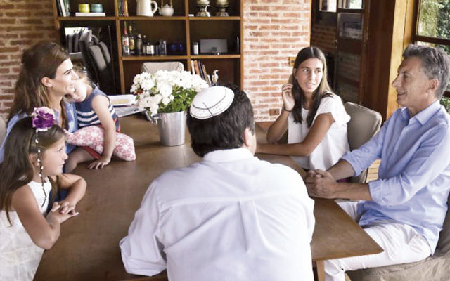 Newly elected Argentine President Mauricio Macri, right, invited the family of the late prosecutor Alberto Nisman to his home in January. Clockwise to his left are Rabbi Marcelo Polakoff; Nisman's daughter Kala; Macri's wife Juliana and daughter Antonia, and Nisman's daughter Iara. (Courtesy of the Office of the President of Argentina)