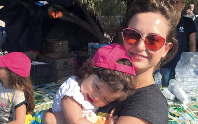 """Actress Milana Vayntrub, the """"AT&T Girl,"""" volunteering with Syrian refugees in Lesbos, Greece. (Courtesy of Vayntrub/Can't Do Nothing)"""