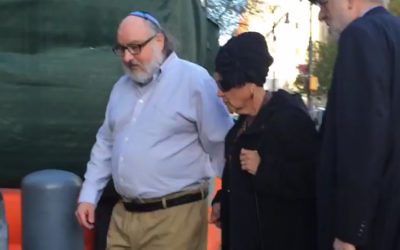 In this still image from video provided by WCBS-TV, convicted spy Jonathan Pollard, left, arrives at a federal courthouse in New York with his wife, Esther, to check in at a probation office just hours after he was released from prison on Friday, Nov. 20, 2015. Pollard's release was the culmination of an extraordinary espionage case that complicated American-Israeli relations for 30 years and became a periodic bargaining chip between two allies. (Ilana Gold/WCBS-TV via AP)