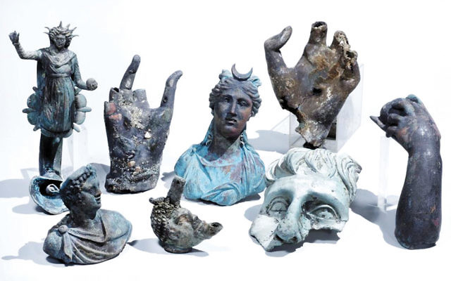 Some of the rare bronze artifacts that were discovered in Caesarea. (Photo by Clara Amit, courtesy of the Israel Antiquities Authority)