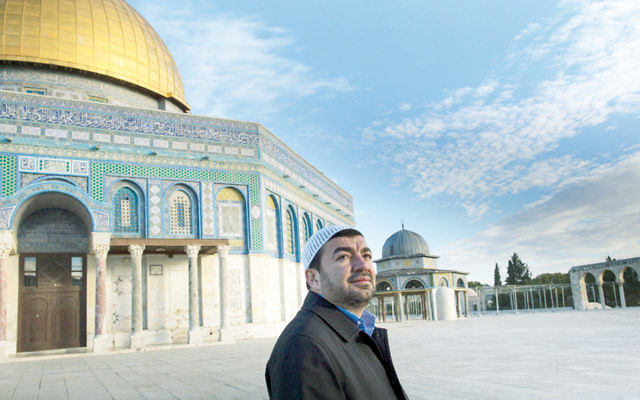 Imam Abdullah Antepli stands outside the Al-Aqsa Mosque in Jerusalem.