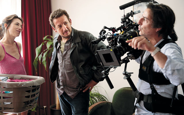 """Director Yvan Attal, right, with Charlotte Gainsbourg and Dany Boon during the filming of """"The Jews""""  in Paris. (Courtesy of Wild Bunch Productions)"""