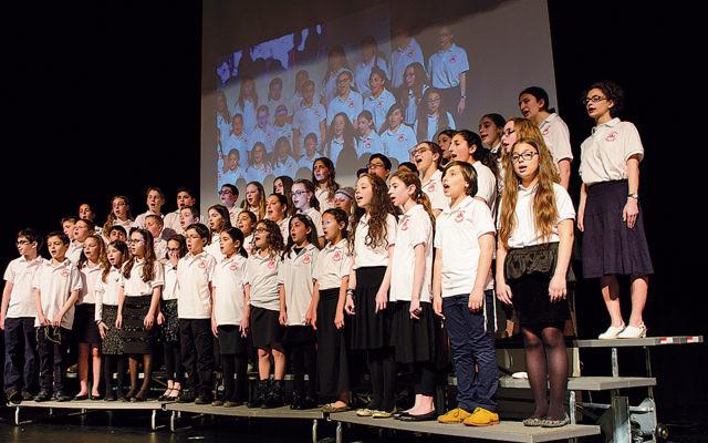 The Yavneh Academy choir performs.