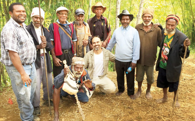 Golan Levi of MyHeritage with local residents in Konom in the highlands of Papua New Guinea. (Tamar Friesland)