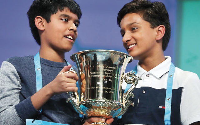 Nihar Janga, left, and Jairam Hathwar are co-champions of the 2016 Scripps National Spelling Bee, held in National Harbor, Maryland. (Alex Wong/Getty Images)
