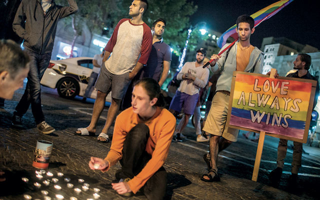 Young Israeli LGBT equality activists lighting candles at Zion Square in Jerusalem in solidarity with the victims of the shooting attack in Orlando on June 12. (Hadas Parush/Flash90)