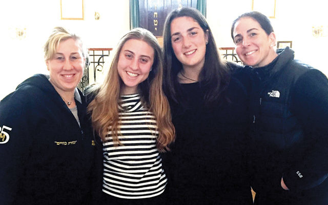 Shanna Lehmann Wolf, her daughter Arianna, Rebecca Packer, and her mother, Tutu, stand together in a synagogue in Lublin.