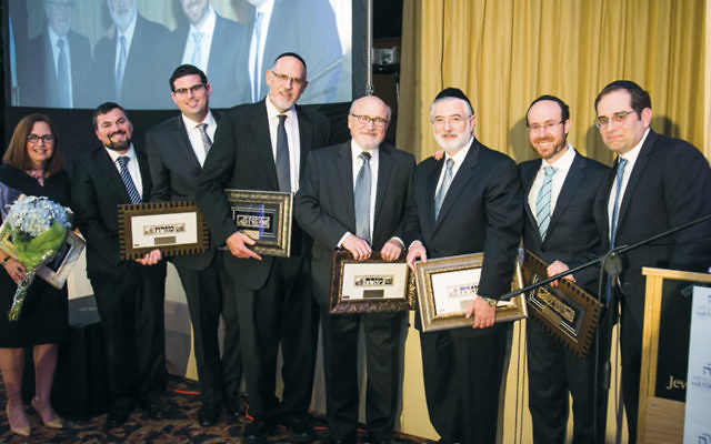 Heichal HaTorah's building committee (Photos by Kruter Photography)