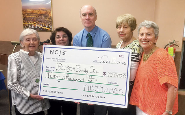 Mitch Schonfeld, CEO of Bergen Family Center, accepts the NCJW donation. (Courtesy NCJWBCS)