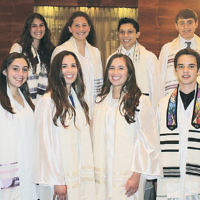 Students from Temple Beth El of Closter's 10th grade confirmation class stand with Cantor Rica Timman and Rabbi David Widzer. Ninth graders from the religious school also participated in the service, which was held on Shavuot.