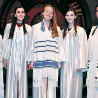 During erev Shavuot services, Temple Emeth in Teaneck held a confirmation ceremony, led by Cantor Ellen Tilem, left, and Rabbi Steven Sirbu. The confirmands, from left, Regina Fink, Naomi Friedman, and Claire Fink, received gifts, including a chumash. Claire Fink received the Wilford Weill Memorial Essay award. (Barbara Balkin)