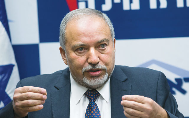 Avigdor Liberman, head of the Yisrael Beiteinu party, speaks at a news conference at the Knesset last month. (Yonatan Sindel/Flash90)