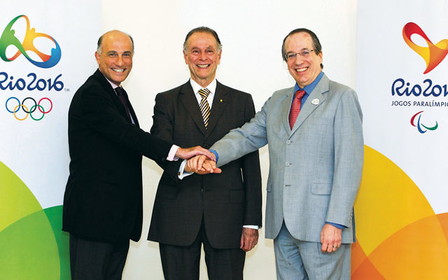 The Jewish trio in charge of the Rio Olympics: Carlos Arthur Nuzman is flanked by Sidney Levy, left, and Leonardo Gryner. (Marcio Rodrigues)