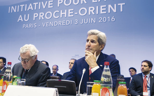 U.S. Secretary of State John Kerry, right, at the international summit in Paris to revive the Israeli-Palestinian peace process on June 3. (Saul Loeb/AFP/Getty Images)