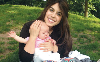 Myriam Schottenstein, founder of the sheitel review website ShayTell, and her baby. (Myriam Schottenstein)