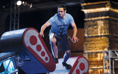 "Akiva Neuman, an Orthodox Jew who is studying to be a rabbi, competing in the Philadelphia qualifying round of ""American Ninja Warrior."" (Mitchell Leff/NBC)"