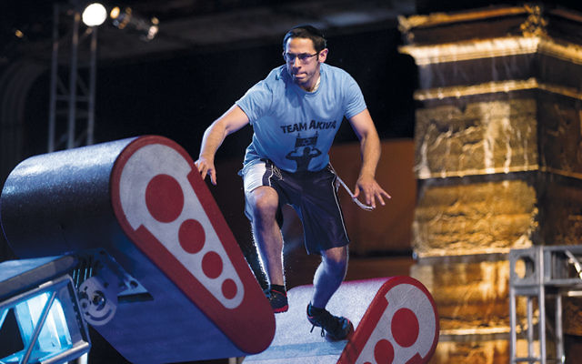 """Akiva Neuman, an Orthodox Jew who is studying to be a rabbi, competing in the Philadelphia qualifying round of """"American Ninja Warrior."""" (Mitchell Leff/NBC)"""