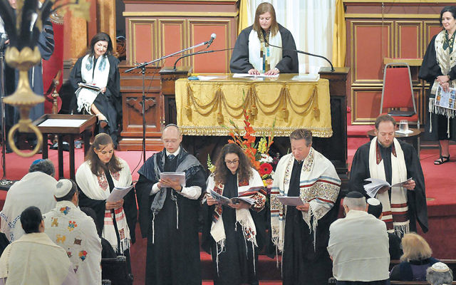 Members of the 2016 rabbinical class of the Hebrew Union College-Jewish Institute of Religion read their class prayer at an ordination ceremony at the Plum Street Temple in Cincinnati, Ohio, in May. (HUC-JIR via Facebook)