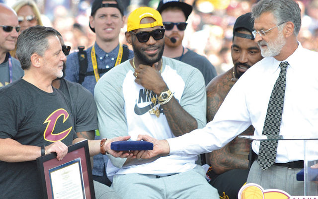 LeBron James, center, and Dan Gilbert, left, the owner of the Cleveland Cavaliers, who is Jewish, celebrate the Cavaliers' NBA championship last week. (Cleveland Jewish News)