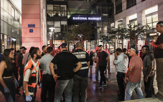 Israeli security forces at the scene where a suspect terrorist opened fire at the Sarona Market shopping center in tel Aviv, on June 8, 2016. The suspect shot and wounded 9 people, one of them critically injured, in a suspected terror attack in the center of the city. Photo by Miriam Alster/Flash90