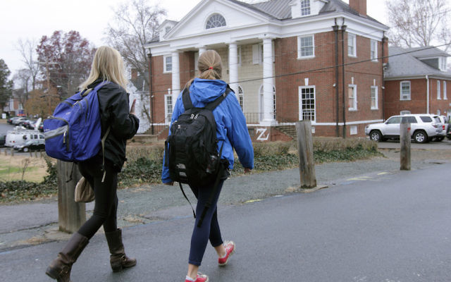 An illustrative photo of students walking on campus. (Jay Paul/Getty Images)