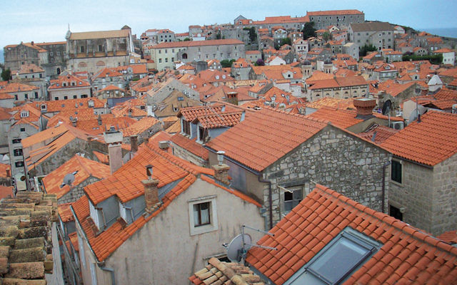 The red-tiled rooftops of Dubrovnik are among the lovely city's many beautiful vistas; it draws many tourists and often chases away locals. (Photos by Miriam Rinn)