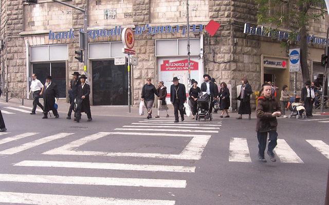 Charedim get ready for shabbat in Jerusalem's Kikar Shabbos neighborhood.