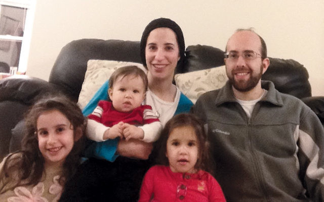 Aryeh and Hadassah Gielchinsky will be observing Tisha B'Av in Israel this year with their children, Miriam, 7, Yoni, 20 months, and Batya 4.