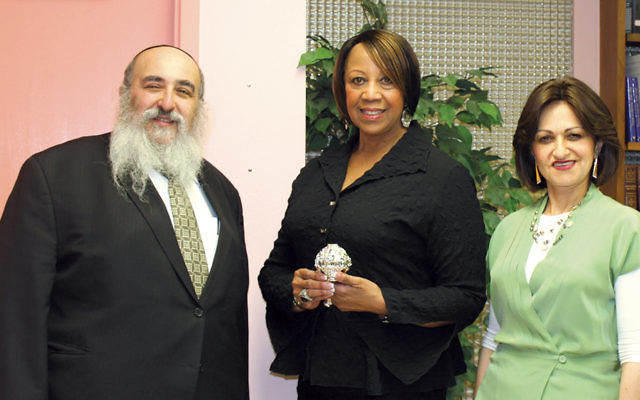 Rabbi Mordechai and Shterney Kanelsky, Bris Avrohom's executive director and associate director, respectively, flank Assemblywoman Sheila Oliver.