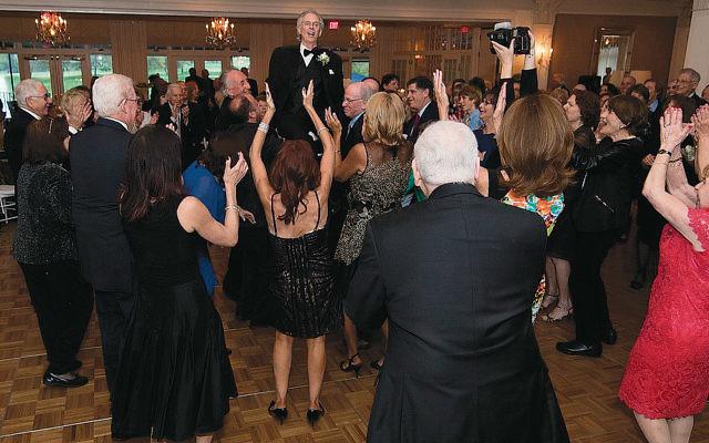 Friends applaud Cantor Charles Romalis. (Photos courtesy Peter Blacksburg)