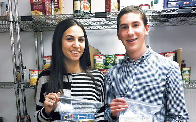 Jaclyn Wildes and Moshe Shoenfeld visit the Center for Food Action in Englewood.