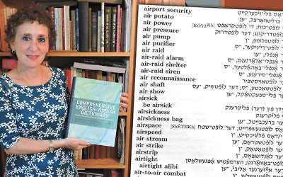 Gitl Schaechter-Viswanath holds the new Comprehensive English-Yiddish Dictionary published last month by Indiana University Press. At right, a page from the dictionary.