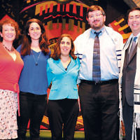 Temple Emeth of Teaneck honored three of its own at a musical service last month. From left, Cantor Ellen Tilem, Rachel Kantor, Cantor Laura Breznick, Rabbi Stefan Tiwy, and Rabbi Steven Sirbu. Laura Breznick recently was ordained as a cantor and her fiancé, Stefan Tiwy, was ordained as a rabbi. Rachael Kantor will be attending the Medical School for International Health at Ben-Gurion University in Beer Sheva, Israel. (Barbara Balkin)