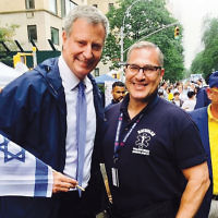 Former Englewood Mayor Michael Wildes, right, was stationed at the medic tent at the Celebrate Israel Parade. He has been a member of Hatzalah, the largest all-volunteer ambulance service in the United States, for nearly 25 years. New York City Mayor Bill DiBlasio is with him.