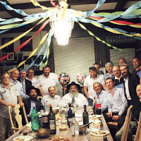 n 5 Last month, Bris Avrohom's executive director, Rabbi Mordechai Kanelsky, center, and its associate director, Shterney Kanelsky, hosted a dinner at their home in honor of Rabbi Kanelsky's birthday. Friends, family, and Bris Avrohom supporters were among the guests. (Courtesy Bris Avrohom)